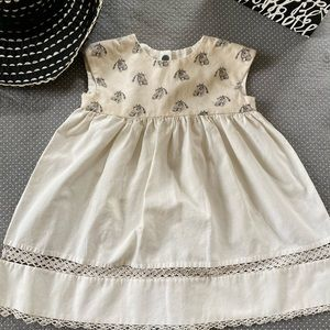 Handmade Dress, Ivory with a horse pattern on top.